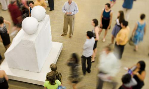 """Visitors surround Louise Bourgeois' sculpture """"Eyes."""""""