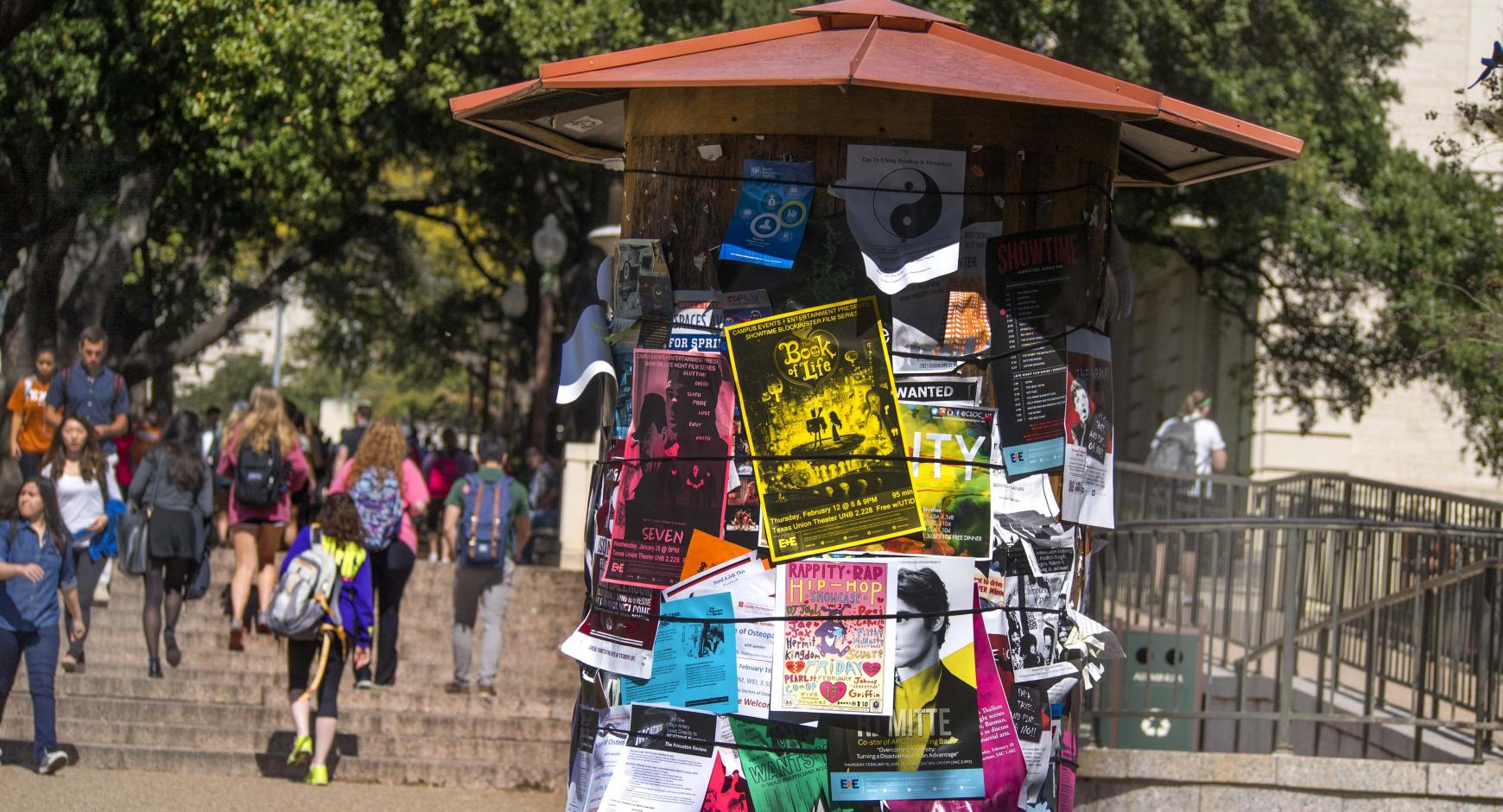 Kiosk with event flyers on the West Mall.