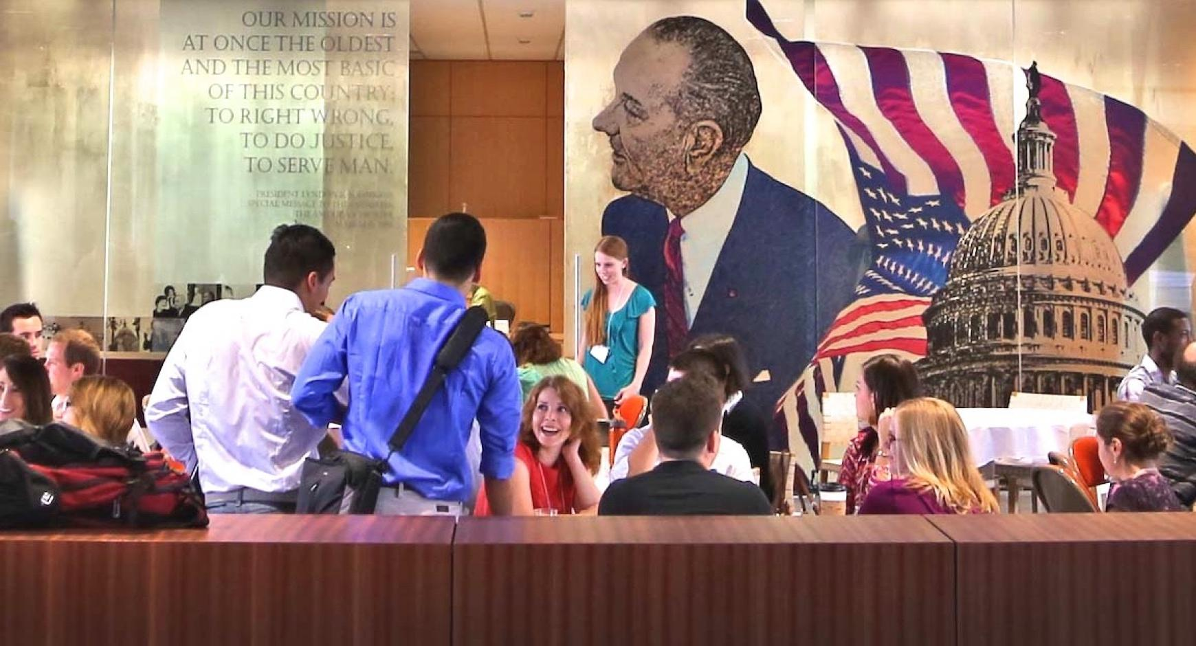 Students mingle inside the LBJ School of Public Affairs.