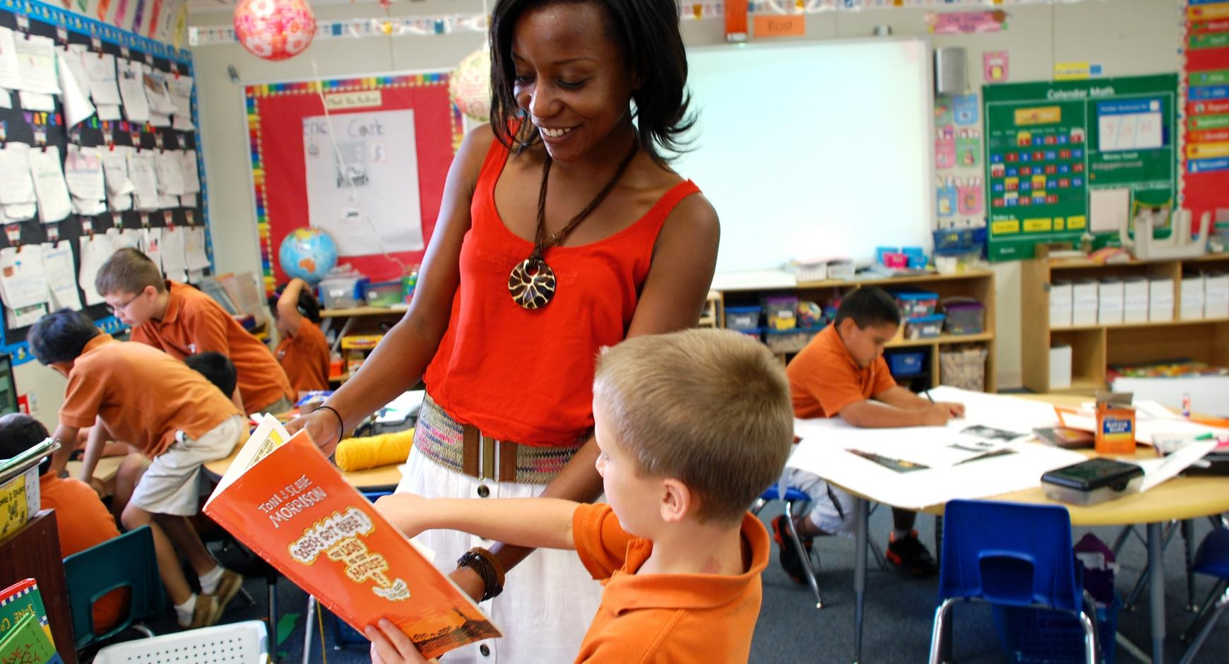 UT Elementary School teacher with student