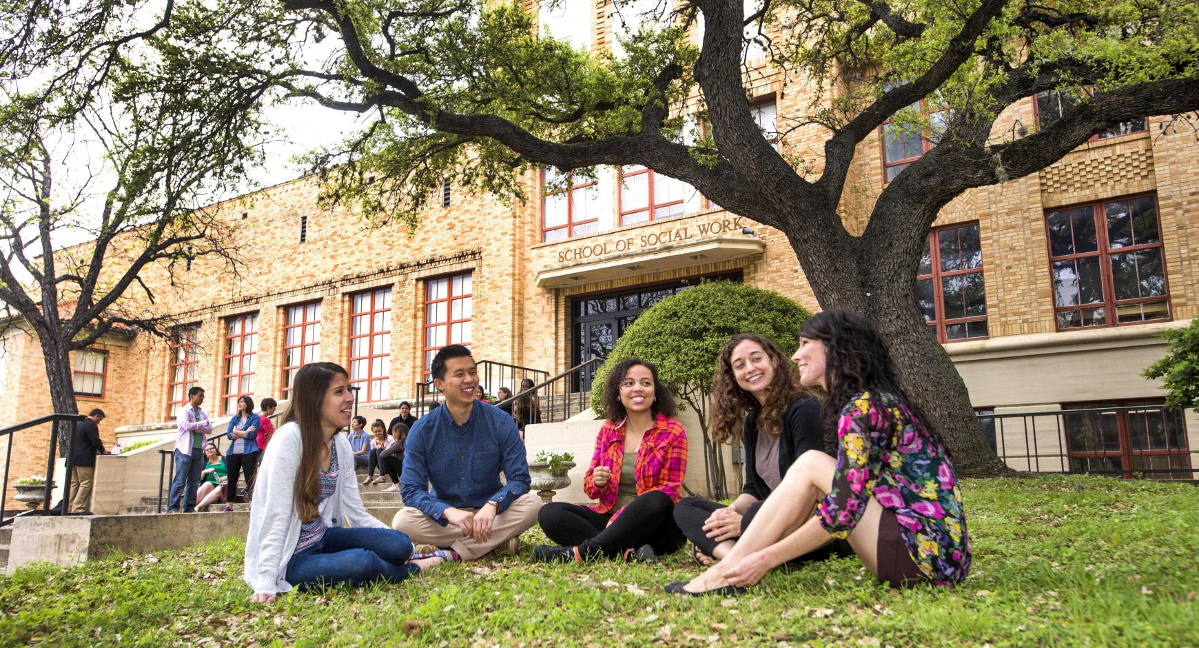 Social work students outside on lawn in front of school building.