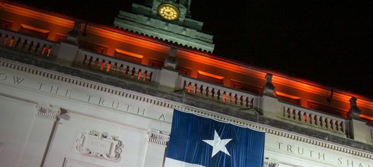 UT Tower at Commencement with Texas Flag