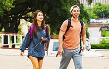 students walking across the main mall on the University of Texas campus